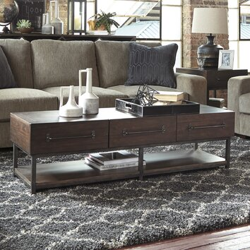 Signature design by ashley starmore coffee table wayfair for Starmore ashley furniture bedroom