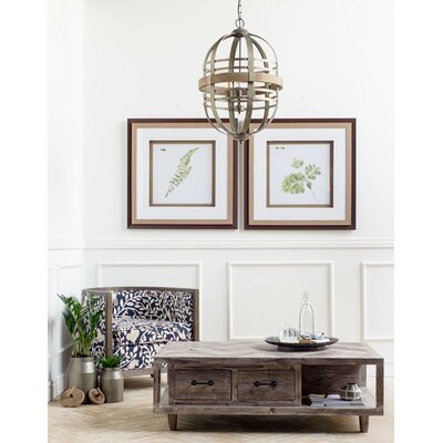August Grove Alicia Coffee Table With Magazine Rack