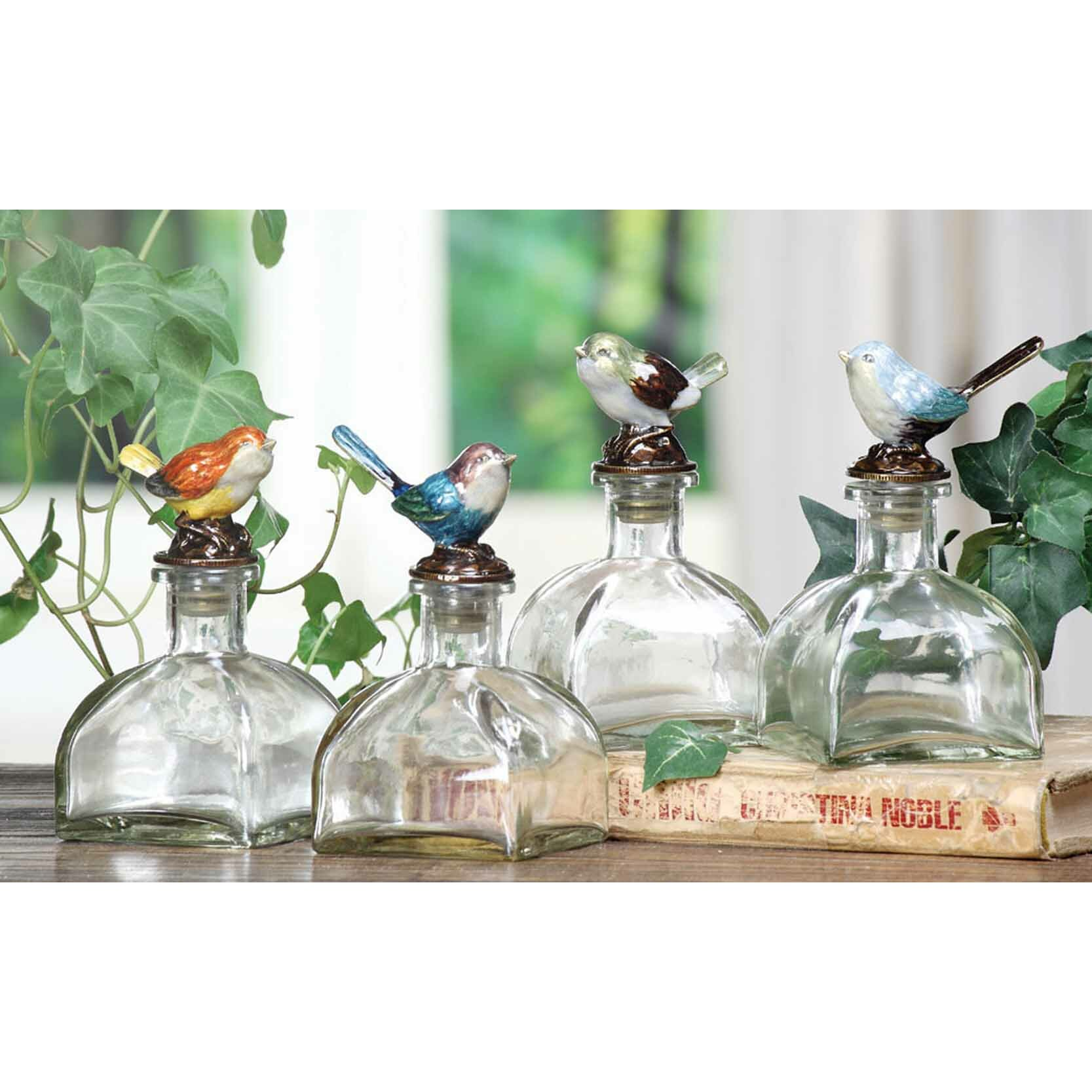 Creative co op decorative glass bottle with pewter bird for Decorative vials