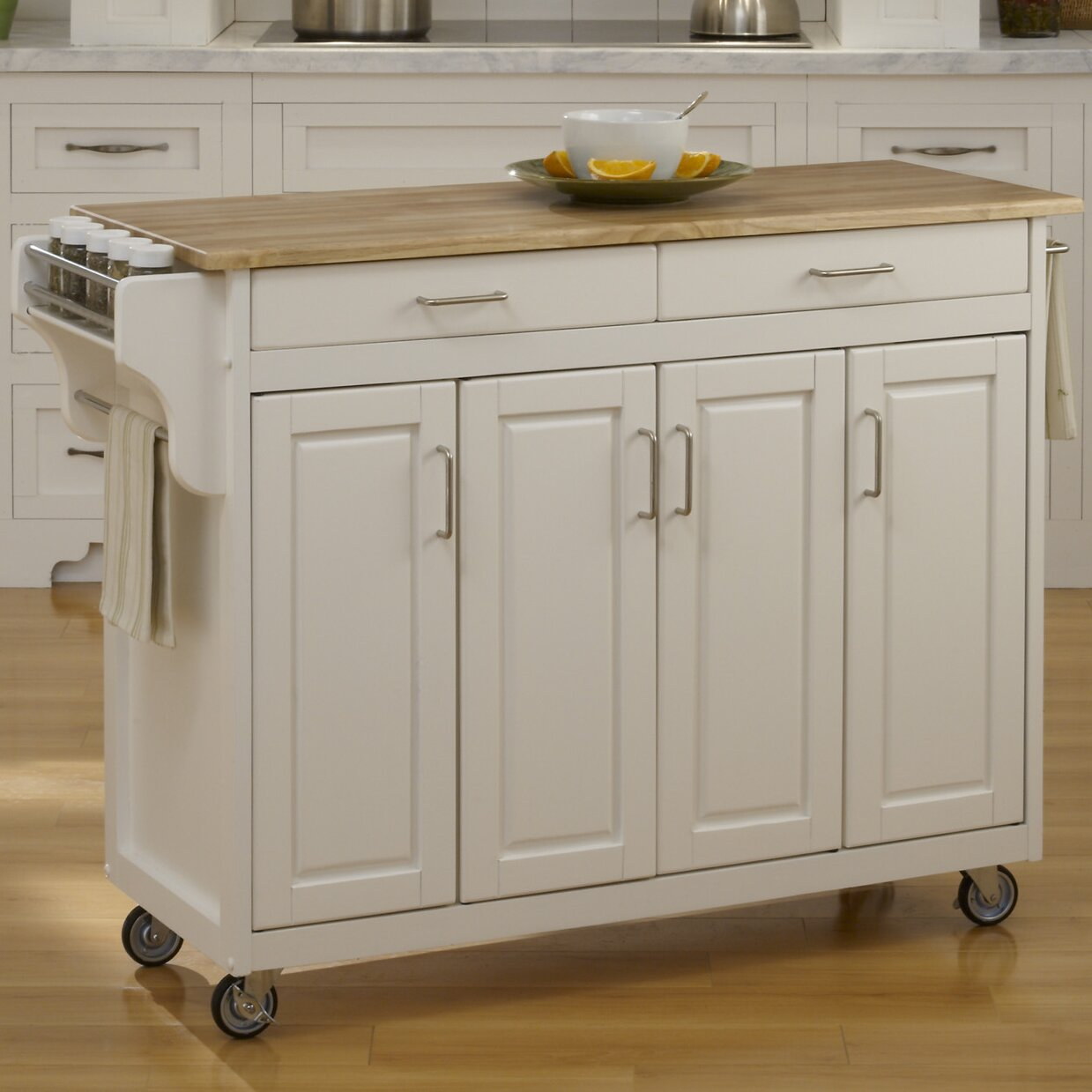 Home styles create a cart kitchen island with natural wood Homestyles com