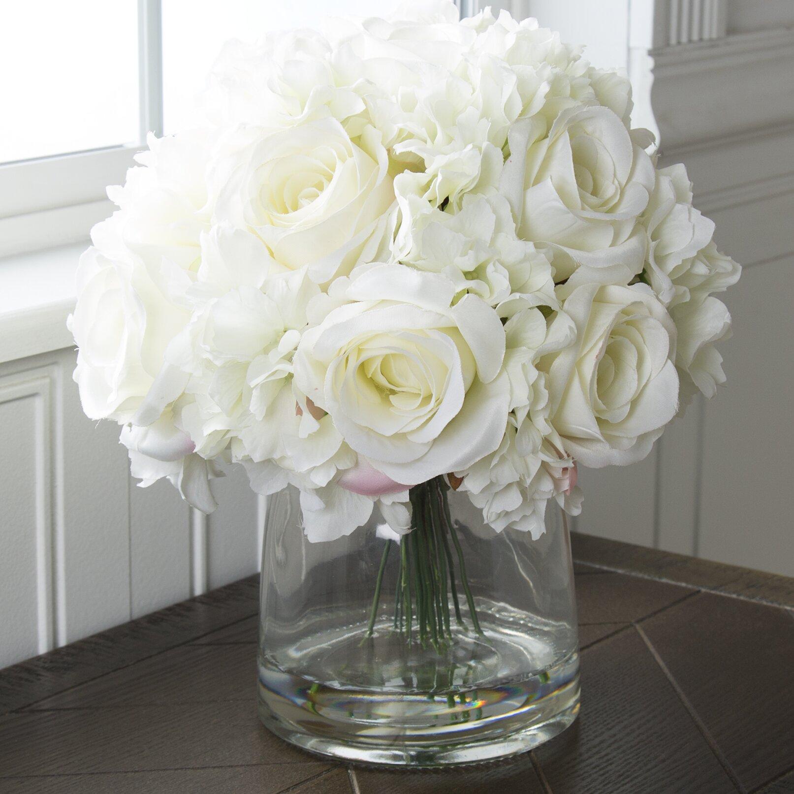 Pure garden hydrangea and rose arrangement in glass vase