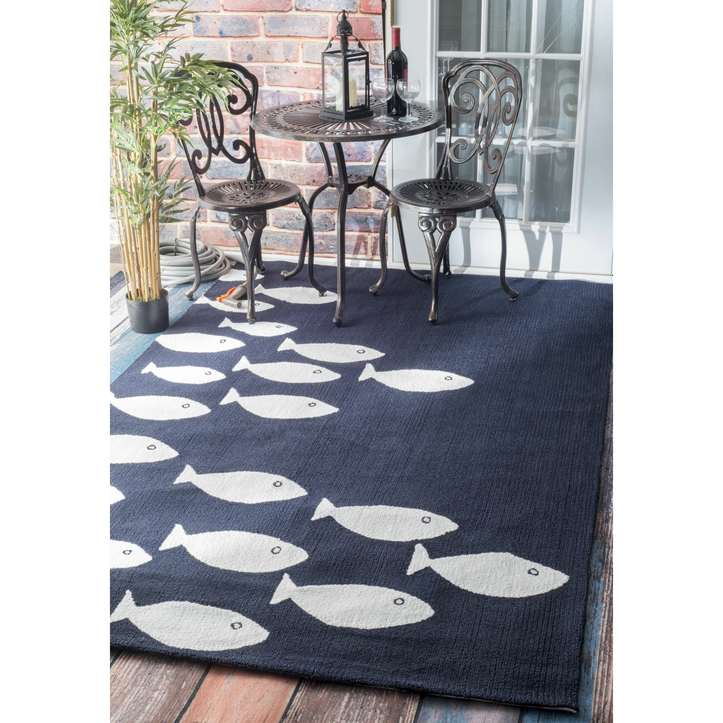 Beachcrest home roeville hand woven navy outdoor area rug for Woven vinyl outdoor rugs